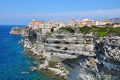 Perched On The Cliff Edge Overlooking The Sea by Bonifacio In Corsica Royalty Free Stock Photography