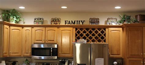 Ideas To Put On Top Of Kitchen Cabinets by Decorating Above The Kitchen Cabinets I Put Suitcases In