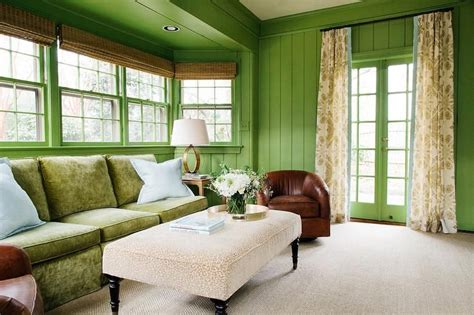 this stunning sunroom stands out with its apple green
