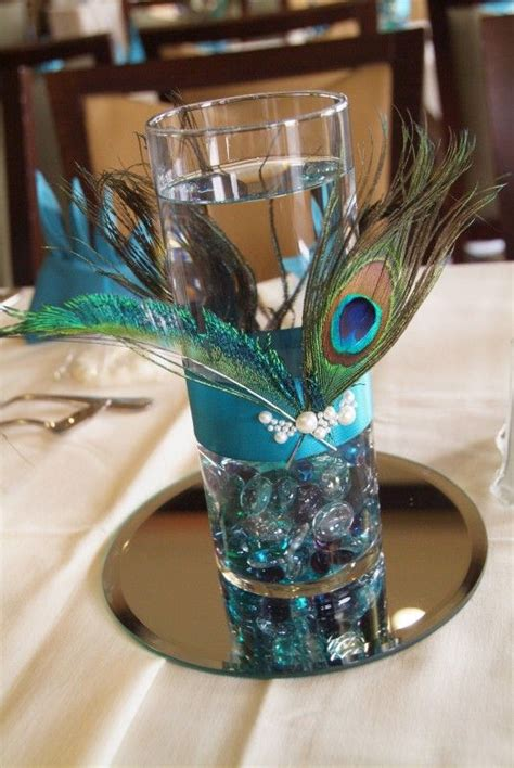 peacock centerpiece   floating candle   water