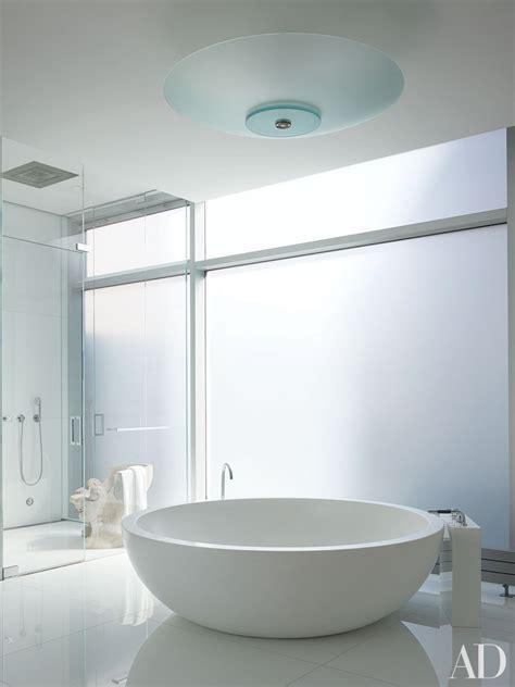 white bathroom design ideas  architectural digest