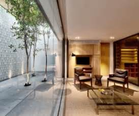 A And Calming Bachelor Pad With Wood And Concrete by Open Tropical Home With Interior Courtyard And Wood Features