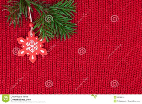 christmas decoration over red wool knitted fabric stock