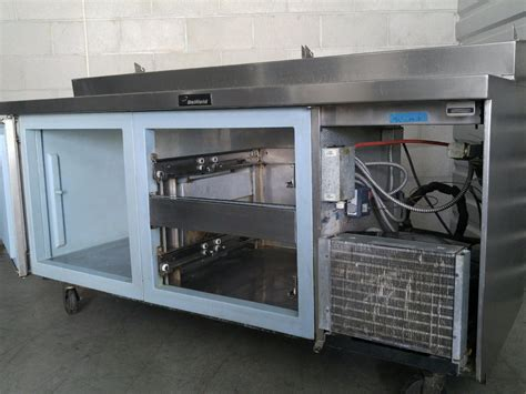 delfield pizza prep table with drawers used delfield 72 quot raised rail 1 door 2 drawer work pizza
