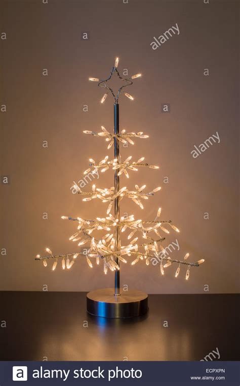 silver metal tree decoration standing on table