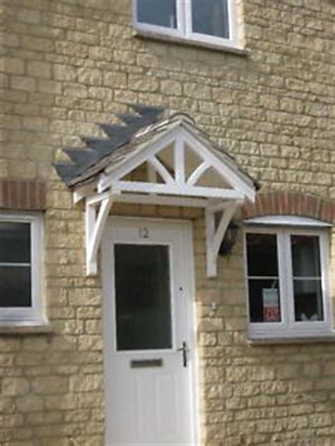 pitched wood canopy wood awning pinterest door canopy canopies  cottage porch
