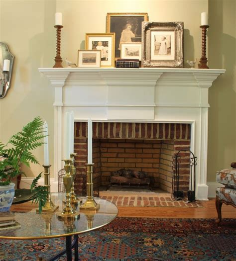 layered pictures  mantel traditional interior design