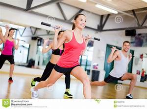 Group Of Smiling People Working Out With Barbells Royalty Free Stock Photo Image: 35508135