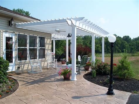 white pergola sted concrete patio design ideas