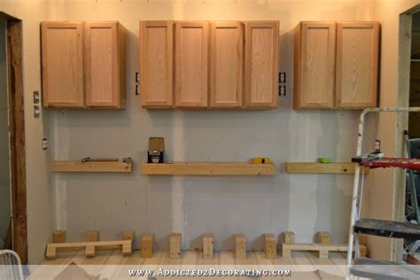 wall of cabinets installed plus how to install