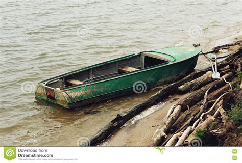 Old Boat Oars by Old Green Boat With Oars Stock Photo Cartoondealer
