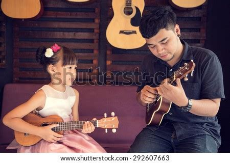 Flexible ukulele lessons only professional and fully vetted ukulele teachers contact your new tutor today and get.learning music: Ukulele Stock Photos, Images, & Pictures   Shutterstock