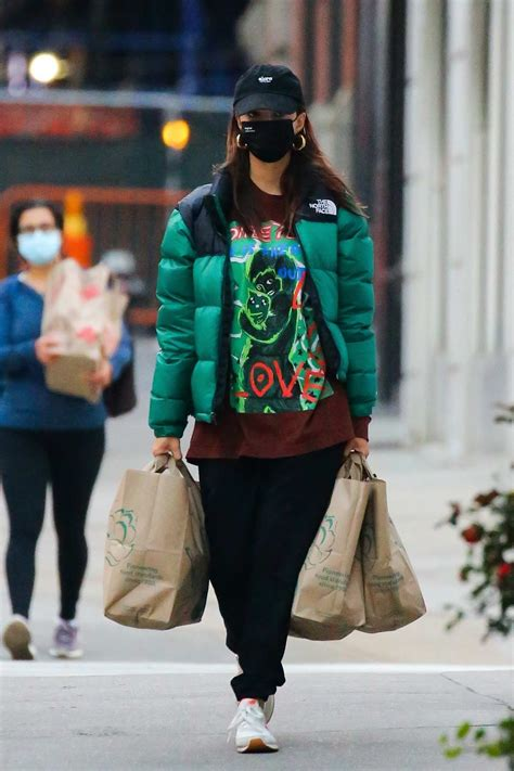 Emily Ratajkowski sports a graphic tee with green puffer ...