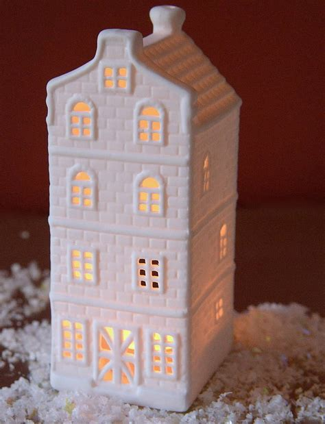 Ceramic House by A Set Of Ceramic House Tea Light Holders By