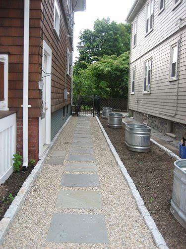 side walkway side yard stock tanks landscaping network