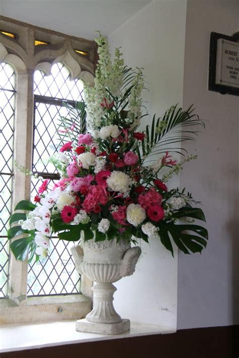 pedestals floral decorators instagram flower design events pink church pedestal flower