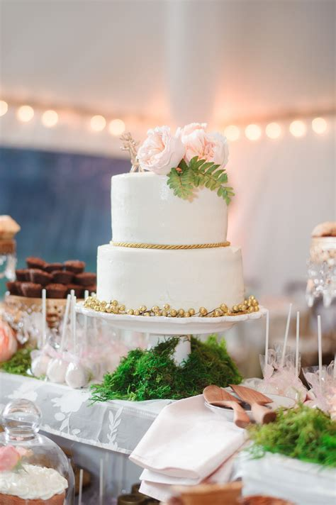 tiered white wedding cake  gold accents