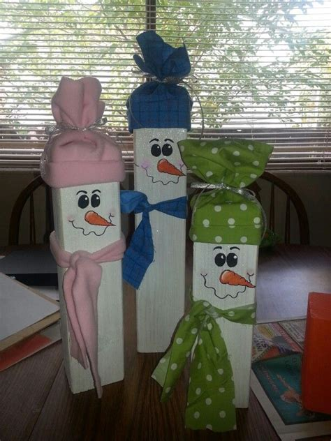 ideas for decorating iron fence posts for christmas fence post snowmen crafts i want to do decorations wood crafts