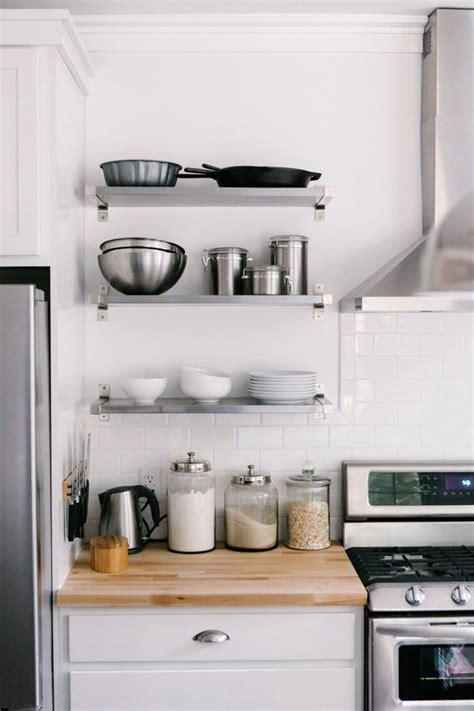 stainless shelves industrial kitchen pinterest how to style your open kitchen shelving the baker via