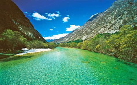 emerald green soca river trenta slovenia summer photo