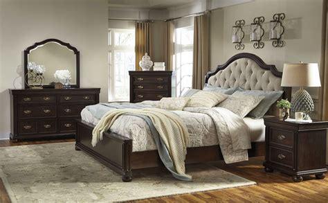 moluxy dark brown upholstered sleigh bedroom set     ashley
