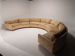 White Leather Sofa With Back Connected With Half Round
