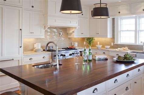 White Kitchen Island With Dark Wood Countertop