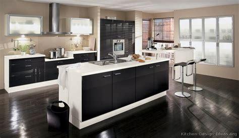 espresso kitchen island a black and white kitchen by alno with a bi level island 3596