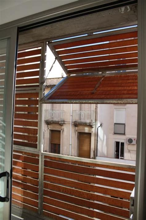 wooden louvered shutter protecting balcony  filtrs