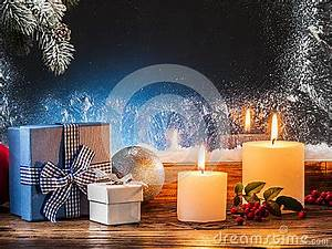 Gift Boxes Candle Lights And Frozen Window Stock