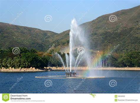 city park water and light installation is here at in a park with rainbow stock photography image Inspirational