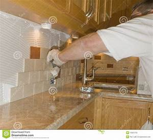 Ceramic tile installation on kitchen backsplash 12 royalty for Install ceramic tile backsplash