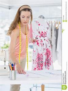 Female Fashion Designer Working On Floral Dress Royalty ...