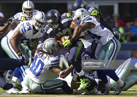 robert turbin   seattle seahawks rushes  ball