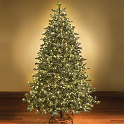white pre lit artificial christmas tree