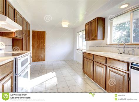 white cabinets tile floor white kitchen room with brown cabinets stock photo image 349 | white kitchen room brown cabinets windows tile floor storage combination appliances 38689976