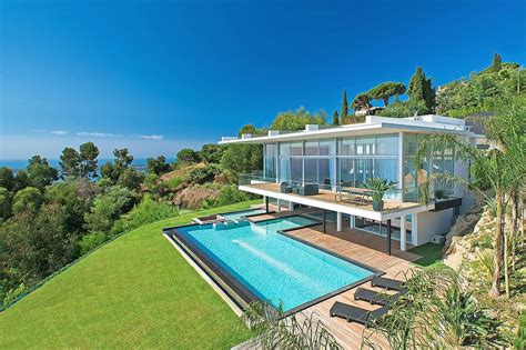 villa sur pilotis avec piscine en dessous gilles broussard