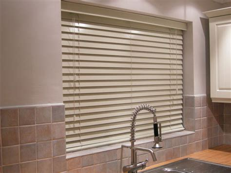 kitchen window treatment ideas  step blinds