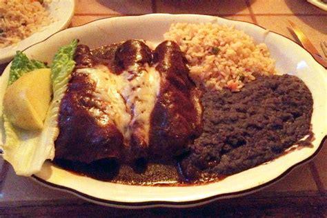 cuisine by region photo enchiladas with mole sauce from el sarape