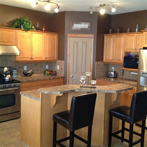 wall color      brown cabinets kitchen