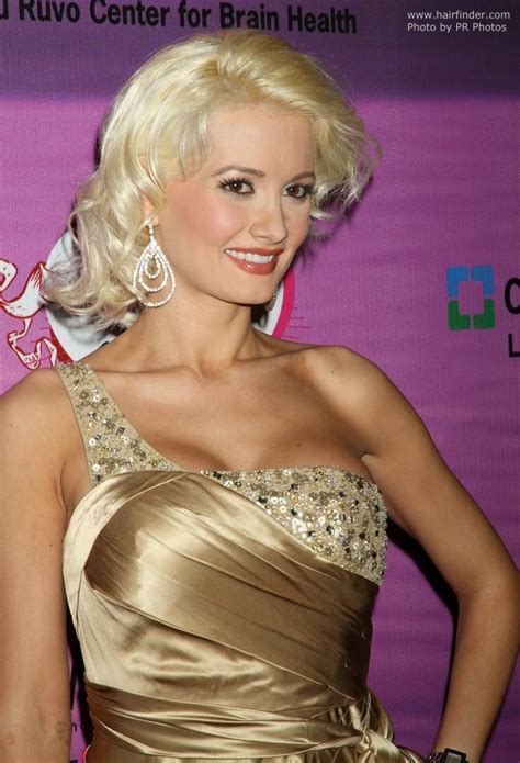 Holly Madison's blonde hair in a retro look with curl and