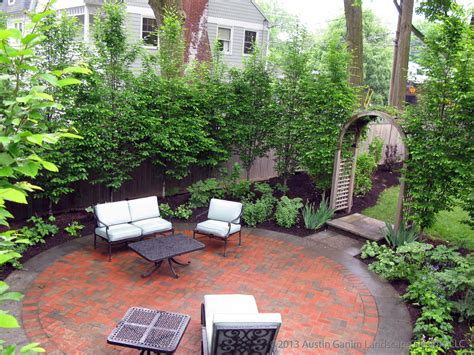 patio landscape designs circular bluestone and brick patio surrounded by european hornbeam hedge and perennial shade