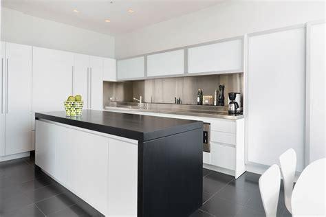 white kitchen with black island black white kitchen island
