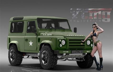 land rover military defender military ladies posing with green land rover defender
