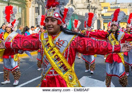 Peruvian Men In Traditional Clothing With Conch Shells