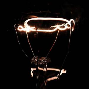 Lit tungsten filament 2, a sample of the element Tungsten ...