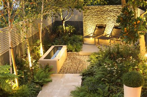 backyard landscaping ideas dense greenery complemented   rock texture  barnsbury townhouse