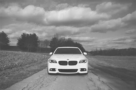 photo bmw   series white front automobile clouds