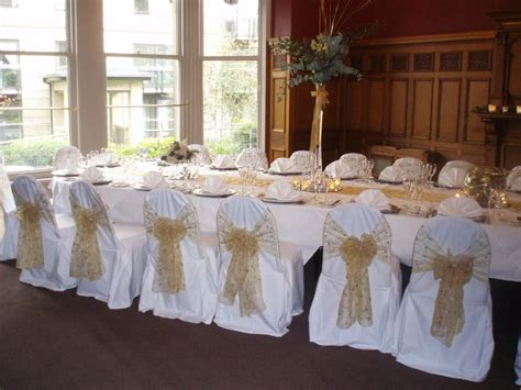 Gold Embroidered Organza Sashes On White Chair Covers At