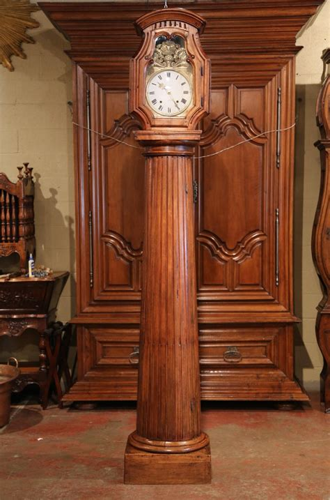 century french carved walnut column grandfather clock